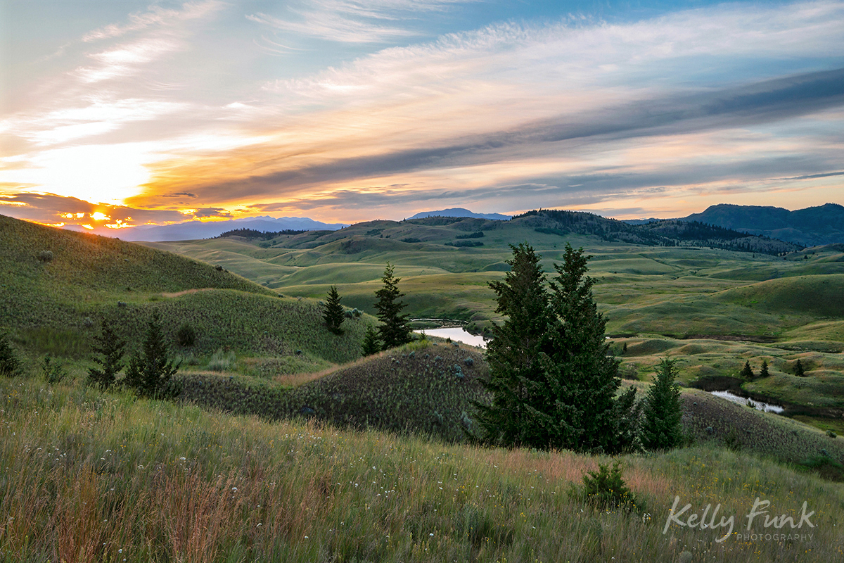 Sunrise bursts onto the Kamloops landscape at the Lac Du Bois grasslands, Thompson Okanagan region, British Columbia, Canada