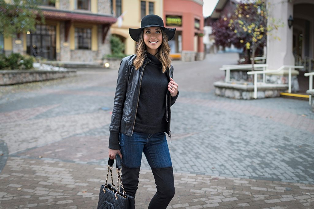 Stylish young woman in the village of Sun Peaks Resort, British Columbia, Canada