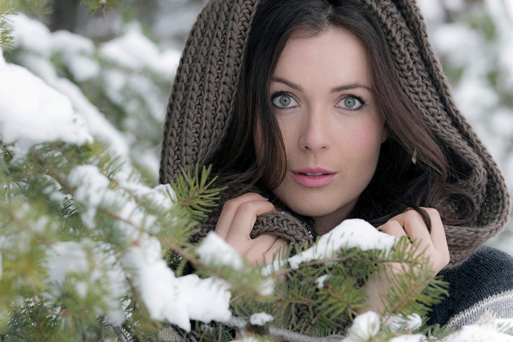 A beautiful young woman poses during a commercial portrait session near Kamloops, British Columbia, Canada
