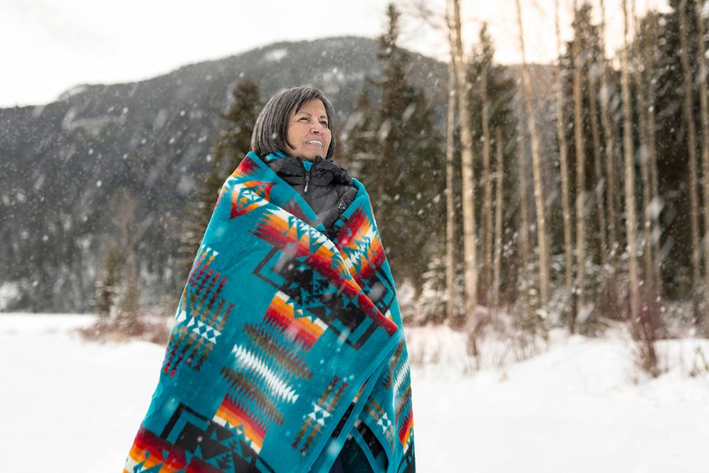 A Secwepemc First Nations elder poses for a commercial portrait for a government website on a beautiful winter's day, near Kamloops, British Columbia, Thompson Okanagan region, Canada
