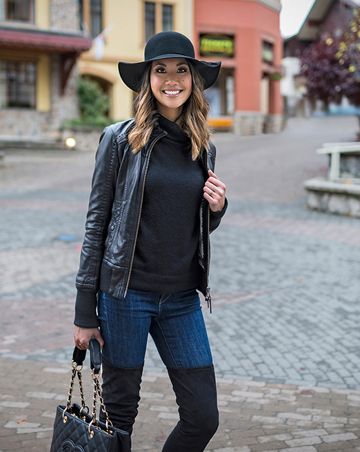 A stylish young woman poses in the village of Sun Peaks, BC, Canada