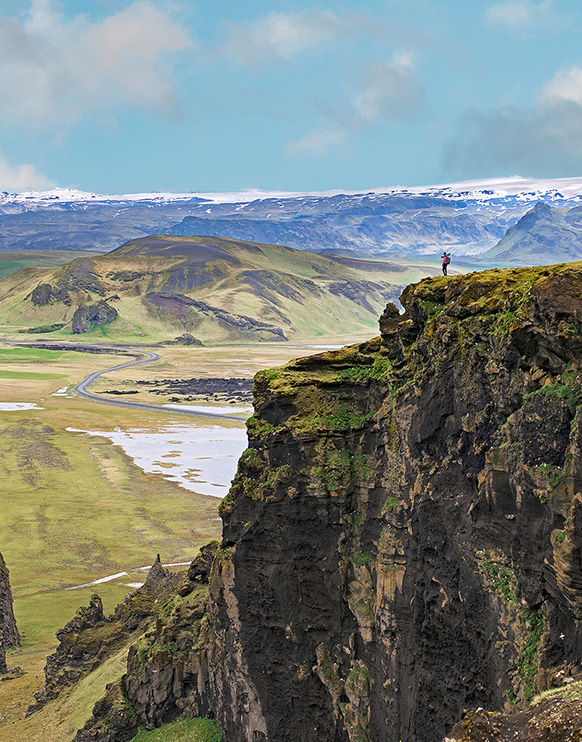 A man surveys the landscape during a photography expedition in Iceland